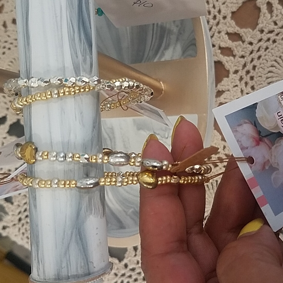 Set of ISBK streachy bracelets... silver and gold beads